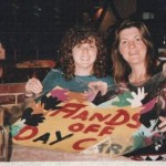 "two women hold a sign that says ""hands off daycare"" at the International Womens Day 1995"