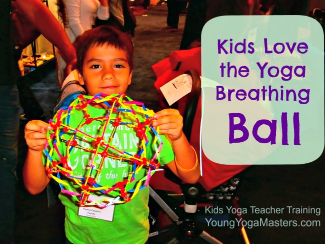 a boy holding a toy called a breathing ball, a ball that expands and contracts and helps kids understand deep breathing
