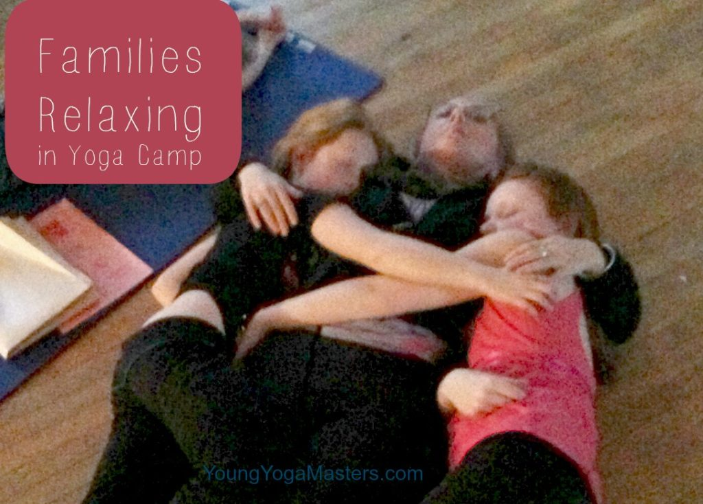 Mother and Daughters share a tender moment in Kids Yoga Camp.